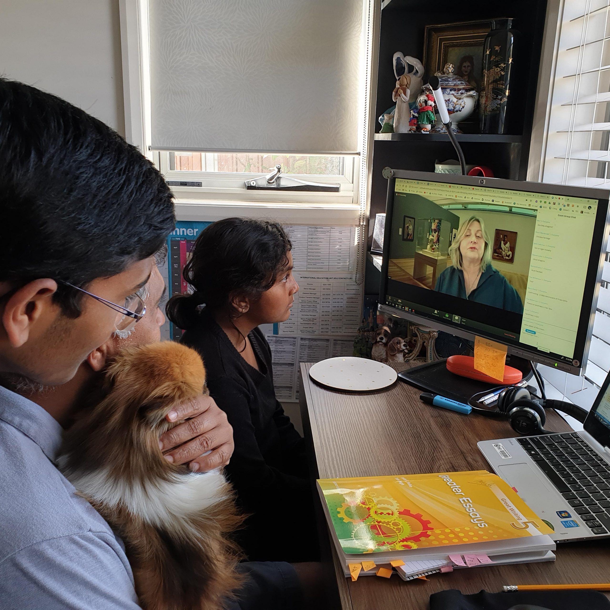 3 family members watching woman on computer screen